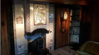Fireplace restoration with Delft tiles