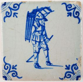 Antique Delft tile with a peddler, 17th century
