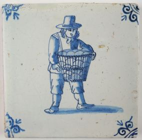 Antique Delft tile with a man carrying goods, 17th century
