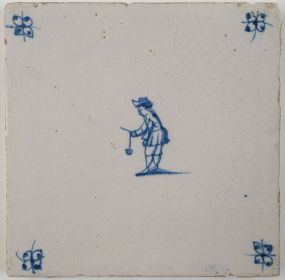 Antique Delft tile with a child playing the brick game, 18th century