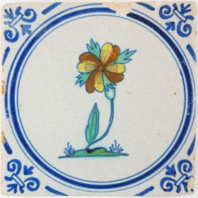 Antique Delft tile with a polychrome Dianthus flower, 17th century