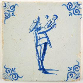 Antique Delft tile with a child blowing bubbles, 17th century