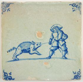 Antique Delft tile with a man fighting a swine, 17th century