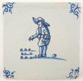 Antiue Delft tile with a child playing a game of marbles, 17th century
