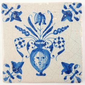 Antique Delft tile in blue with a flower vase with mascaron, 17th century
