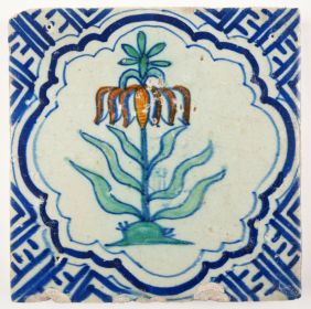 Antique Delft tile with a polychrome crown imperial flower, 17th century