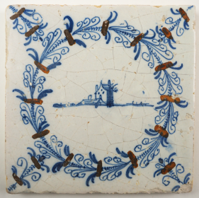 Antique Delft tile with a stronghold in an aigrette border, 17th century Haarlem