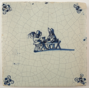 Antique Delft tile with a tavern scene, 17th century