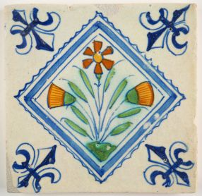 Antique Delft polychrome tile with flowers in a diamond square, 17th century