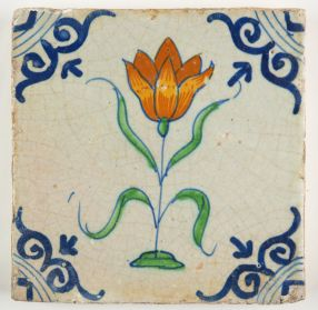 Early 17th century Delft tile with a large orange tulip.