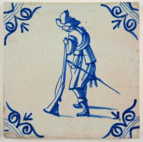 Antique Delft tile in blue with a musketeer loading his musket, 17th century