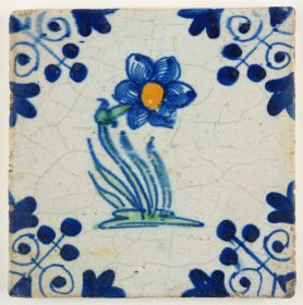 Antique Delft tile with a polychrome flower and the three-dot corner motif, 17th century