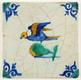 Antique Delft tile with a polychrome bird on pear, 17th century