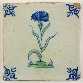 Antique Delft polychrome tile with a carnation flower, 17th century