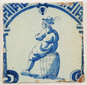 Antique Delft tile in blue with a man resting on a wine barrel, 17th century
