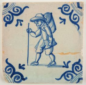 Antique Delft tile in blue with a traveller, 17th century
