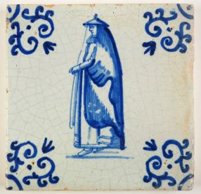 Antique Delft tile in blue with a woman wearing a huik, 17th century