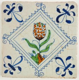 Antique Delft tile with a speckled tulip, 17th century