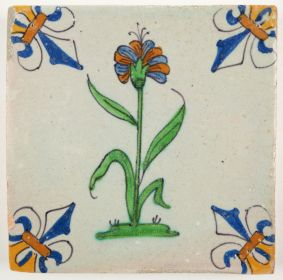 Antique Delft tile with a dianthus flower, 17th century