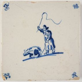 Antique Delft tile with a swineherd, 17th century