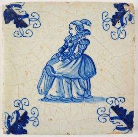 Antique Delft tile with a lady on a chair, 17th century