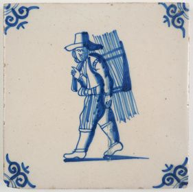 Antique Delft tile with a thatcher, 18th century