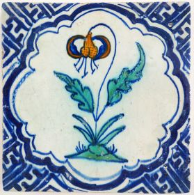 Antique Delft tile with a Turk's cap lily, 17th century