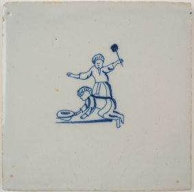 Antique Delft tile with a game of Tip-Cat, 18th century