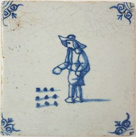 Antique Delft tile with a game of marbles, 17th century