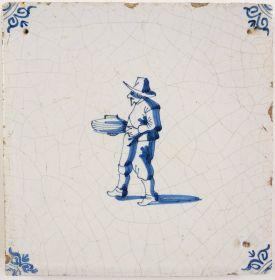 Antique Delft tile with a potter's assistant, 17th century