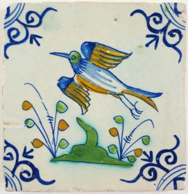 Antique Delft tile with a bird in flight, 17th century