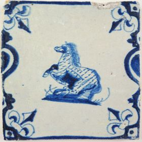 Antique Delft tile with a prancing horse, 17th century