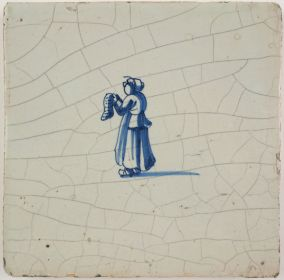 Antique Delft tile with a lady reading, 17th century