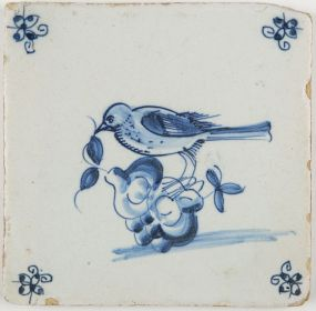 Antique Delft tile with bird on fruits, 17th century