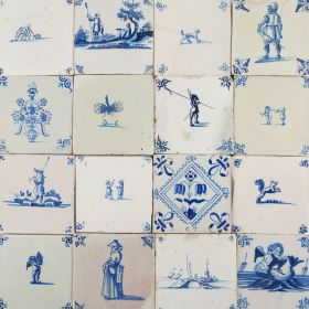 Mixed aged antique Dutch wall tiles as an unique backsplash (aged, blue)
