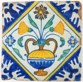 Antique Delft polychrome tile with a richly decorated flower pot, 17th century