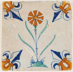 Antique Delft polychrome tile with a dianthus carnation flower, 17th century