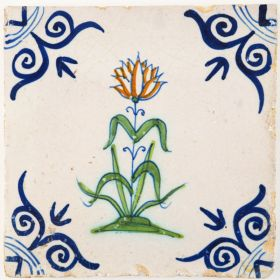 Antique Delft tile with a polychrome flower and large 'ox-head' corner motifs, 17th century