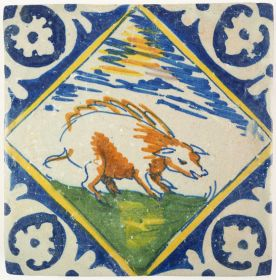 Antique Delft polychrome tile with a swine in a diamond square, early 17th century