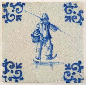 Antique Delft tile in blue with a man skating on ice while holding an ice prick, 17th century