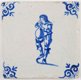 Antique Delft tile with a child blowing up a pig blatter balloon, 17th century