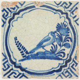 Antique Delft tile in blue with a bird in a Chinese Garden, 17th century