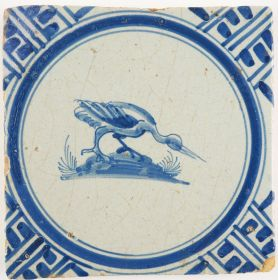 Antique Delft tile in blue with a heron, 17th century