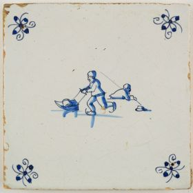 Antique Delft tile with two figures skating on ice, 17th century