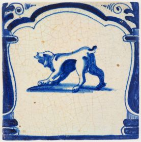 Antique Delft archway tile in blue with a playful dog, 17th century