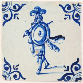 Antique Delft tile with an agile looking soldier wielding his sword and shield, 17th century