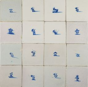 Antique Delft wall tiles in blue with small flowers and fruits, 17th century