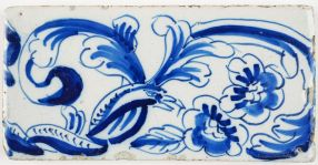 Antique Delft border tile with snakes and birds in a garland of flowers, 18th and 19th century