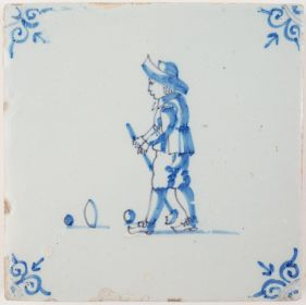 Antique Delft tile depicting a child playing a game of 'beugelen', 17th century