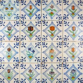 Rare 17th century set of Delft wall tiles with beautiful polychrome flowers in a diamond square